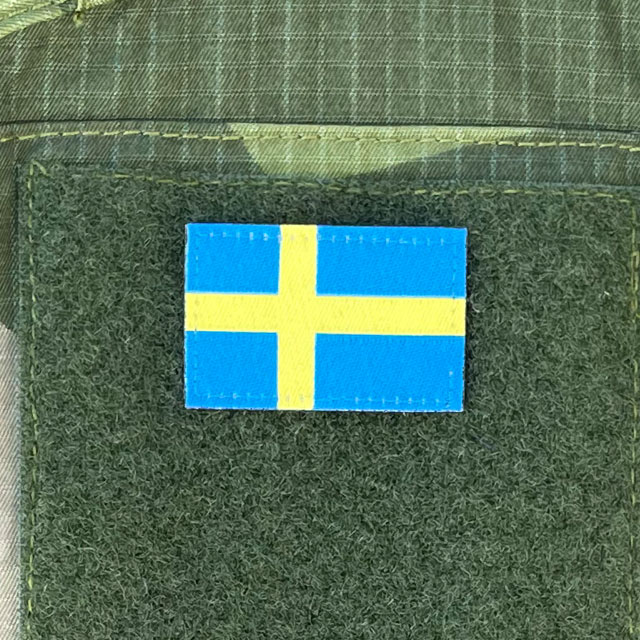 Sweden Flag Hook Patch Arm mounted on green loop on a sleeve