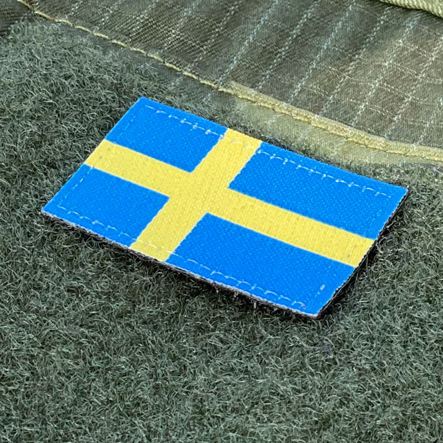 Seen from an angle a Sweden Flag Hook Patch Arm