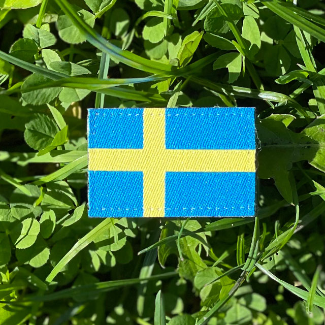 Sweden Flag Hook Patch Arm on the grass