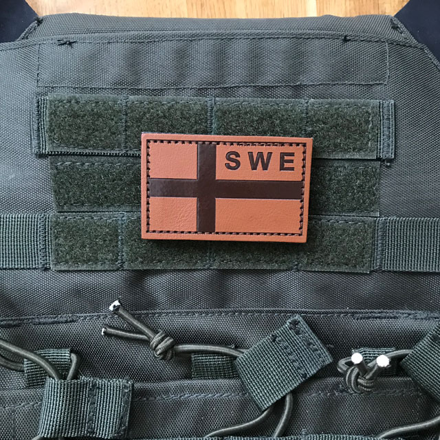 The Sweden Flag Leather Patch accentuating the ranger green plate carrier.
