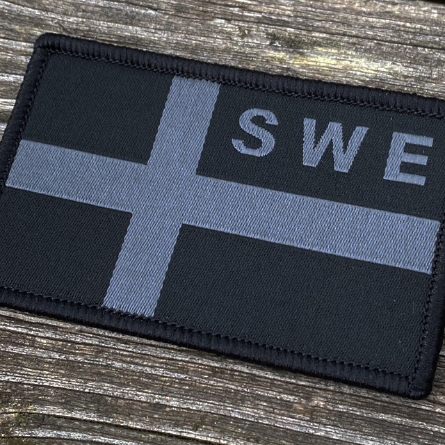A close up on a Sweden Flag OPS Nylon Black/Grey Patch