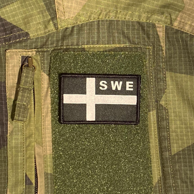 Sweden Flag OPS Black White Patch mounted on a M90 shirt sleeve