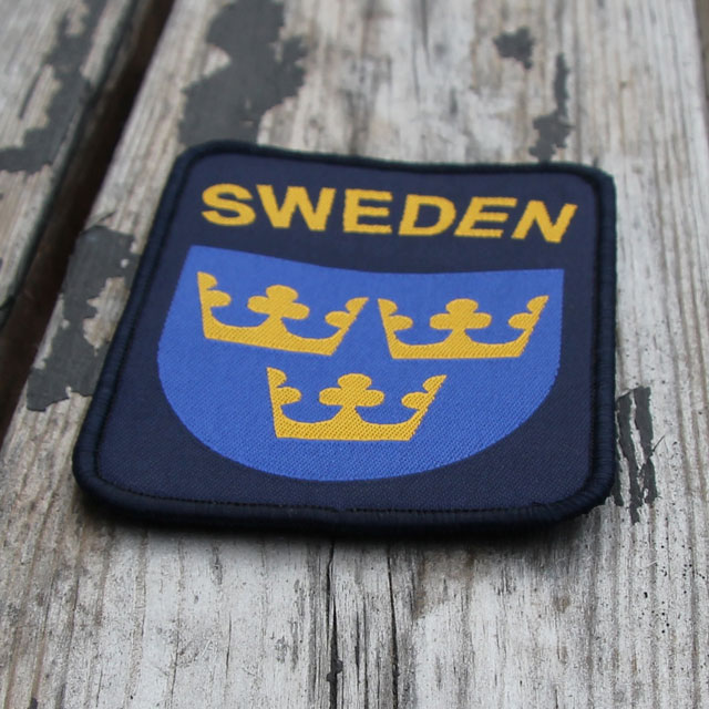 Woody background and a Sweden Hook Patch Navy Blue.