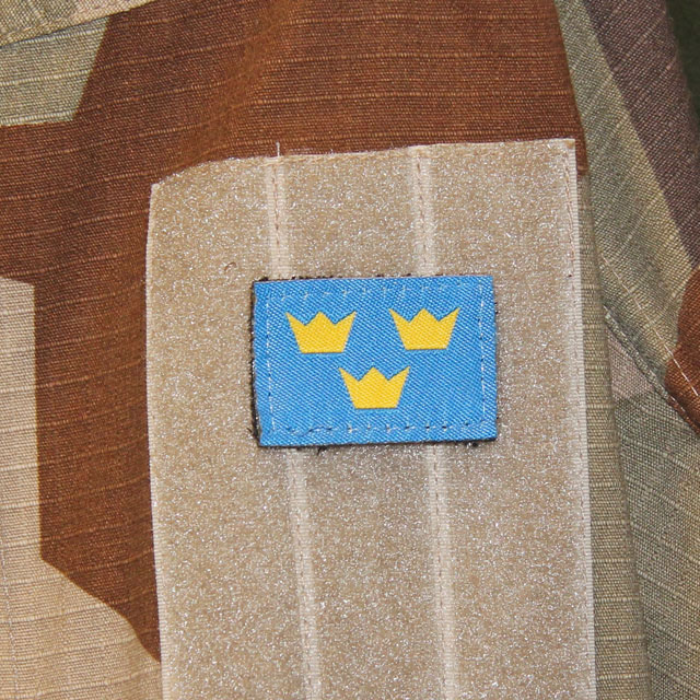 Three Crowns Morale Patch with M90K Desert background.