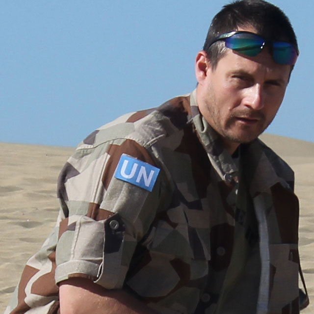 A United Nations Hook Patch Large worn in the desert during product photoshoot.