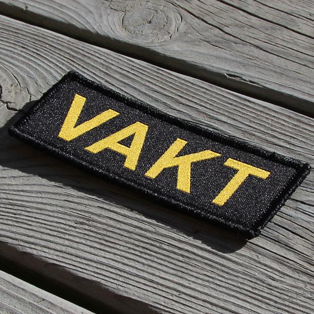 Produktfoto av ett VAKT Kardborremärke.