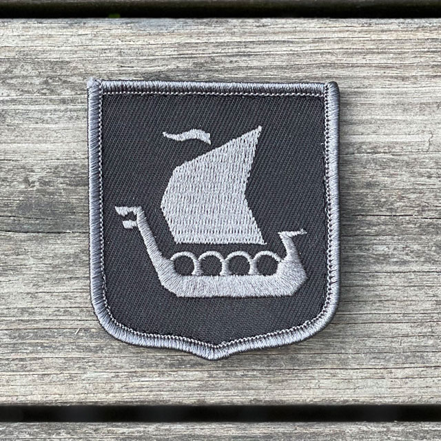 A close up picture of a Viking Ship Shield Large Grey and Black Hook Patch