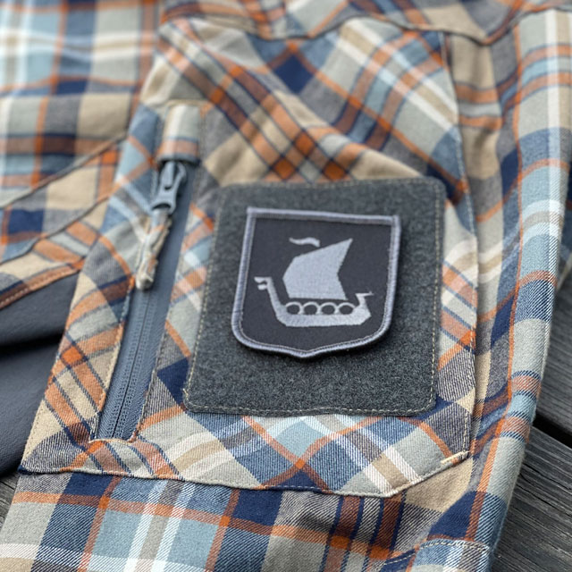 Viking Ship Shield Large Grey and Black Hook Patch mounted on an arm on a shirt