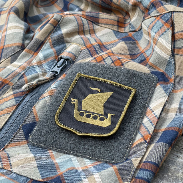 Viking Ship Shield Large Olive and Black Hook Patch seen from an angle mounted on an arm on a shirt