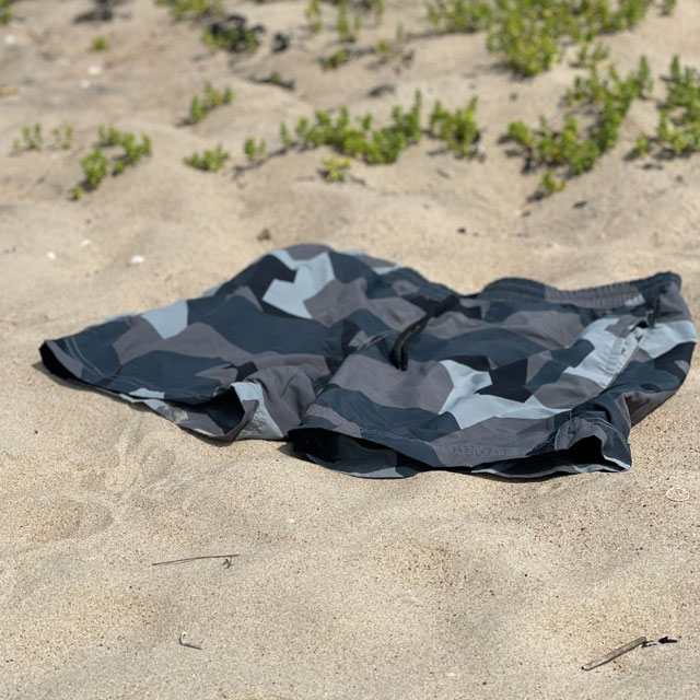POSEIDON Swim Shorts M90 Grey lying on the beach