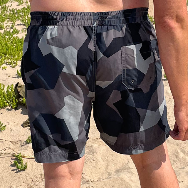 POSEIDON Swim Shorts M90 Grey from TAC-UP GEAR on model seen from the back on the beach