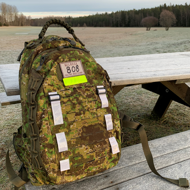 Reflective Stripes Silver mounted on camouflage rucksack during milruck