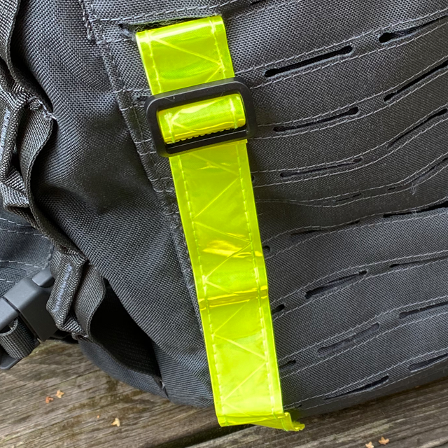 Showing one Reflective Stripe Yellow from the top mounted on a grey rucksack