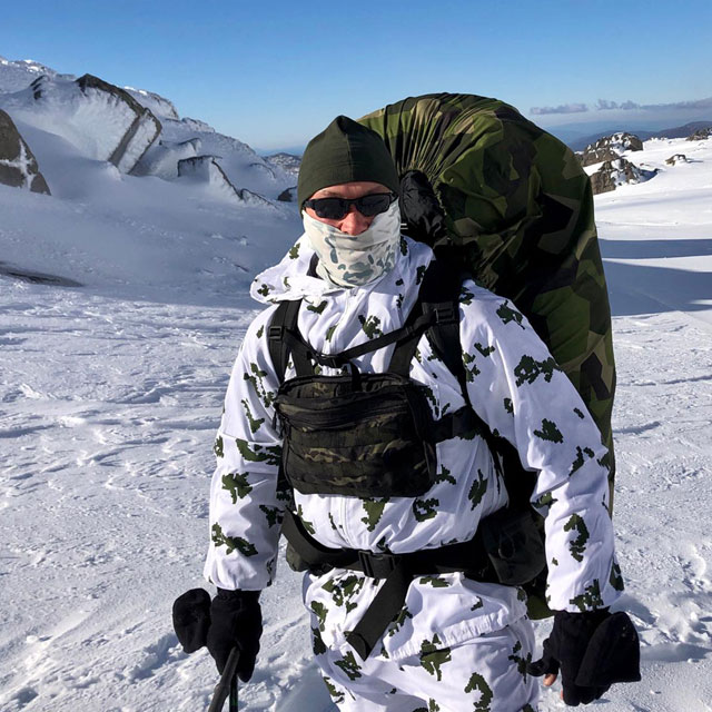 Rucksack Cover M90 worn in snowy conditions