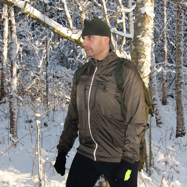 Winter in Sweden and training is on wearing a Running Jacket Green.