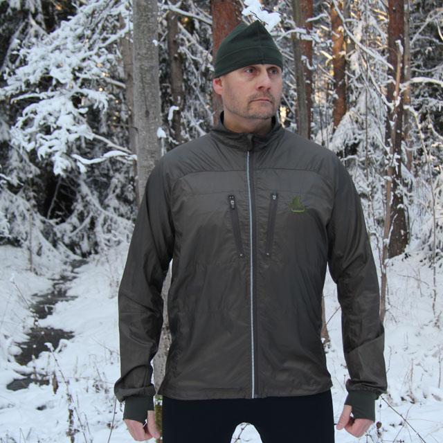 Swedish winter photoshoot of a Running Jacket Green.