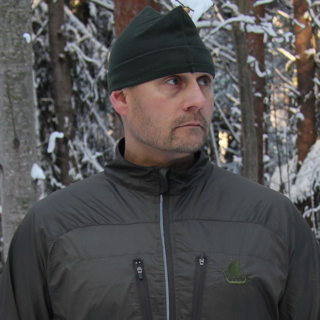 Excellent windbreaker and keeper of warmt even in winter scenery is the Running Jacket Green.