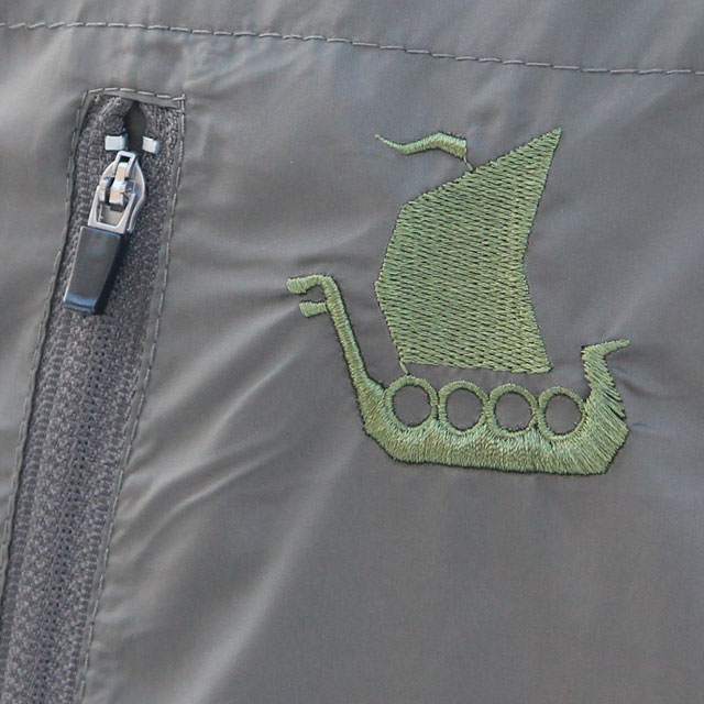 Longboat logo embroidered on a Running Jacket Green.