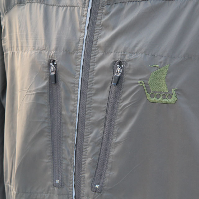 Slight slanted double breast zippers on a Running Jacket Green.
