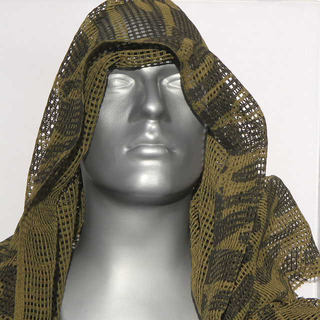 Showing how a Scrim Scarf Black/OD Camo could be draped around the head for concealement.