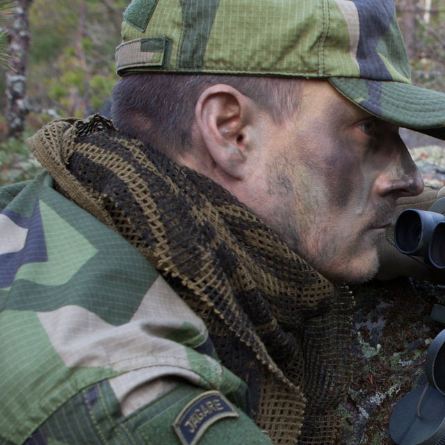 A Scrim Scarf Black/OD Camo worn together with green face camo and M90 uniform.