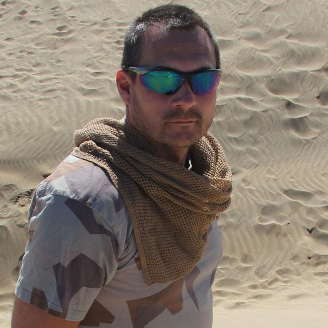 Scrim Scarf Desert Tan worn in the desert during photoshoot.