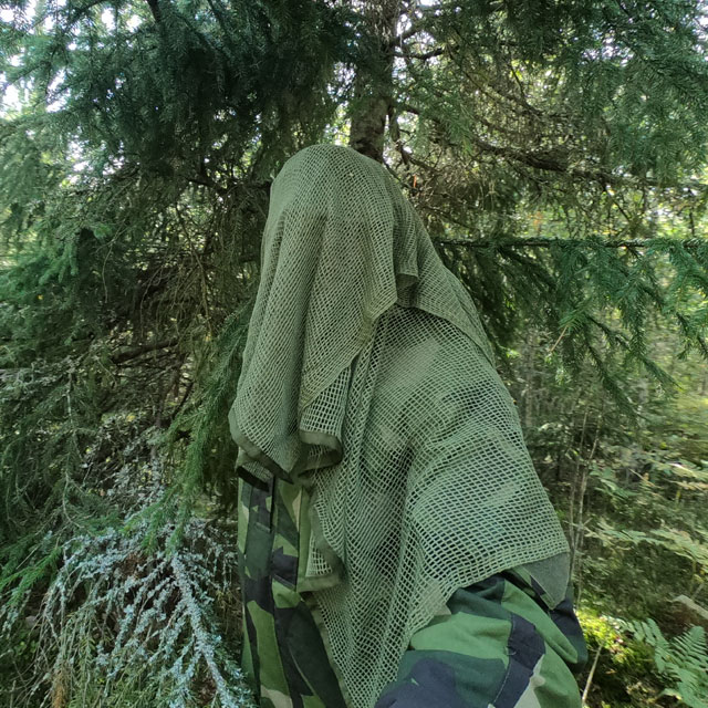 Scrim Net Scarf Green draped and in the Swedish forest