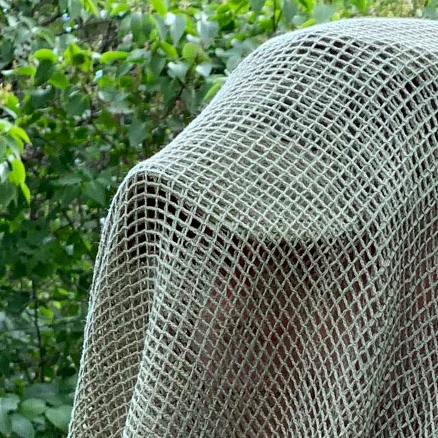 Closeup look on a Scrim Net Scarf Green
