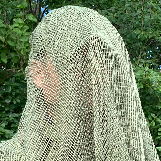 Draped over cap is a Scrim Net Scarf Green