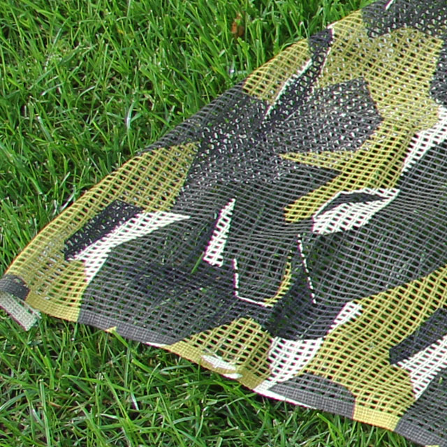 A Scrim Scarf M90 product picture also showing summer grass.