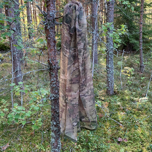 Scrim Net Scarf Multicam hanging on a tree in the Swedish forest