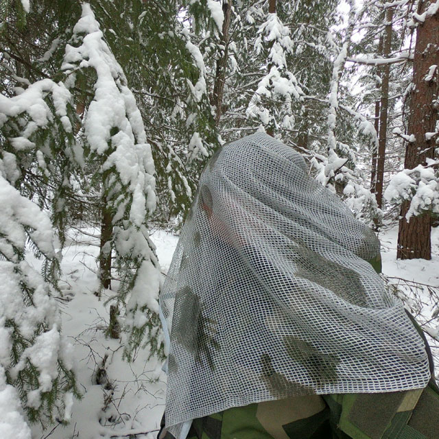 Scrim Net Scarf White Moss draped over man in Swedish winter forest