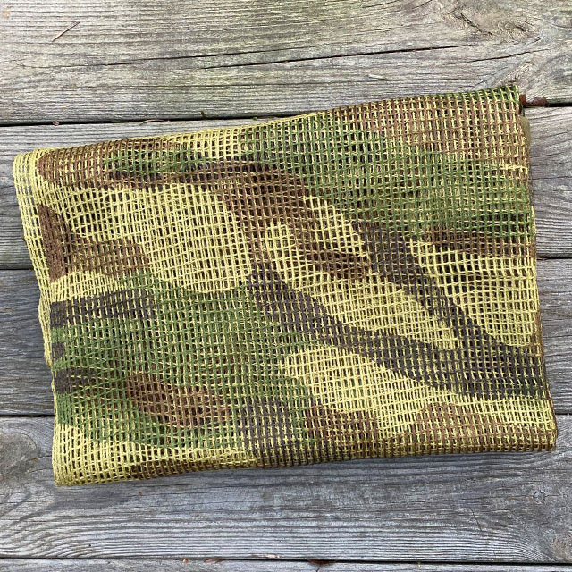 The swooping camouflage on a Scrim Net Scarf Woodland from Tac-Up Gear