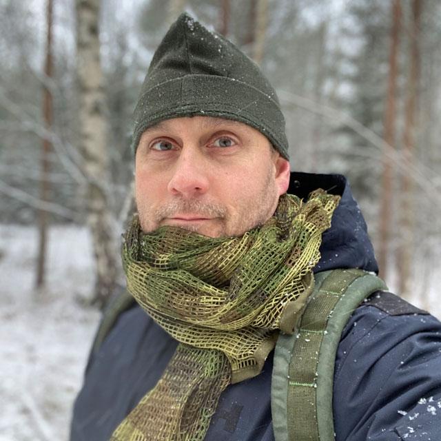 a Scrim Net Scarf Woodland worn in snowy weather