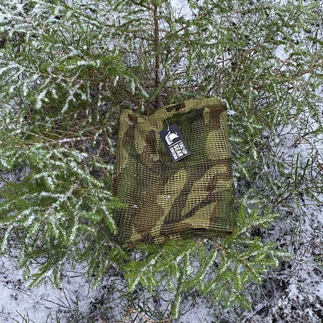 a Scrim Net Scarf Woodland in Swedish forest winter scenery