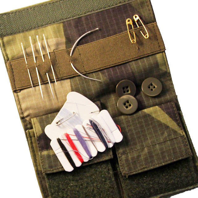 Sewing Case M90 opened and with accessories like needles, buttons and thread in place