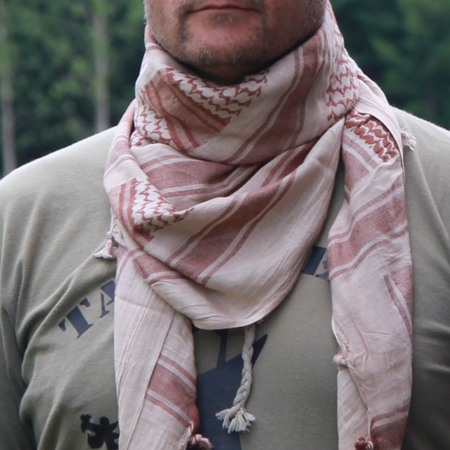 A Shemagh Light Khaki/Brown worn as scarf in Swedish summer scenery.