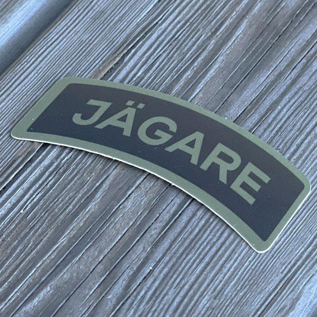 A Sticker JÄGARE Green/Black/Green seen from an angle