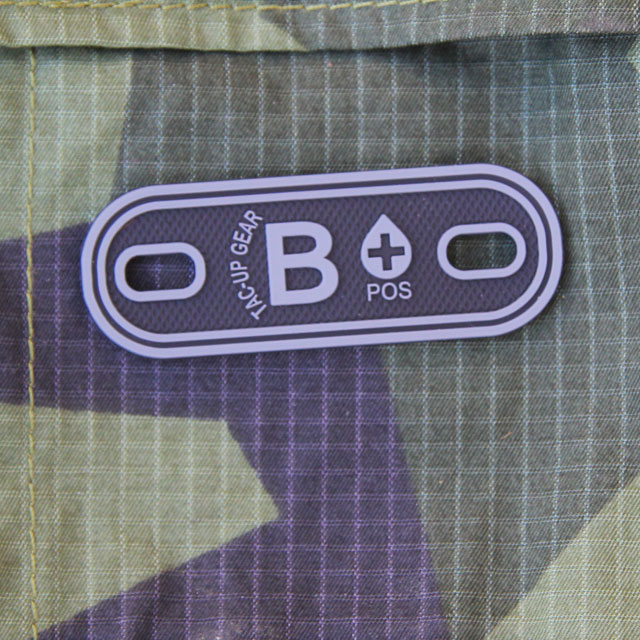 B+ Bloodtype Tag Black PVC with M90 background.