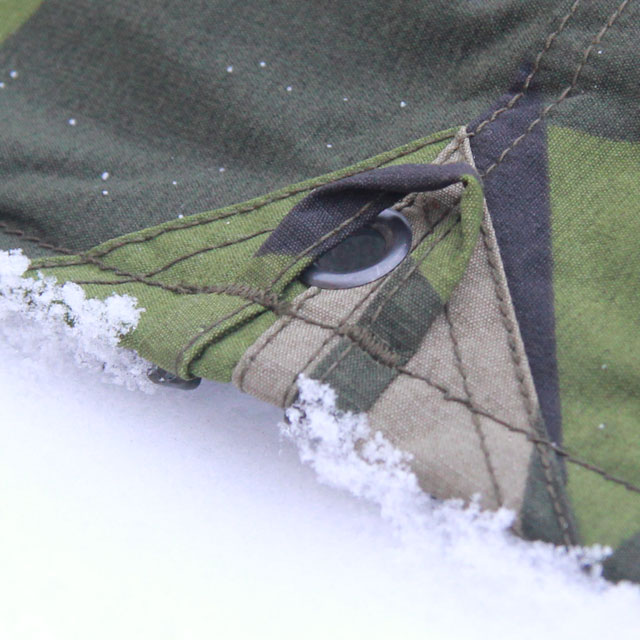 Eyelet and loop on the side of a Tarp Poncho M90.