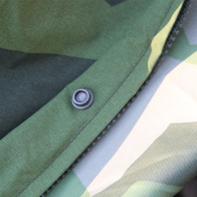 Close up of zipper and eyelet on a Tarp Poncho M90.