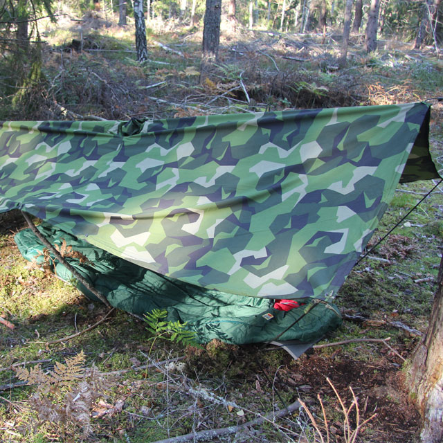 Tarp Poncho M90 set up as a basha in the Swedish forest.