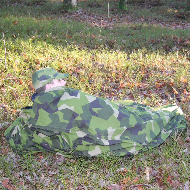 Seen using the Tarp Poncho M90 as a full body cover in Swedish autumn scenery.