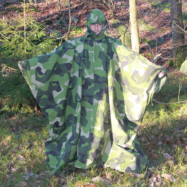 Tarp Poncho M90 used as a poncho and showing how large it is.