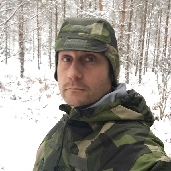 Snow on a Thermal Cap M90 in Swedish winter nature.