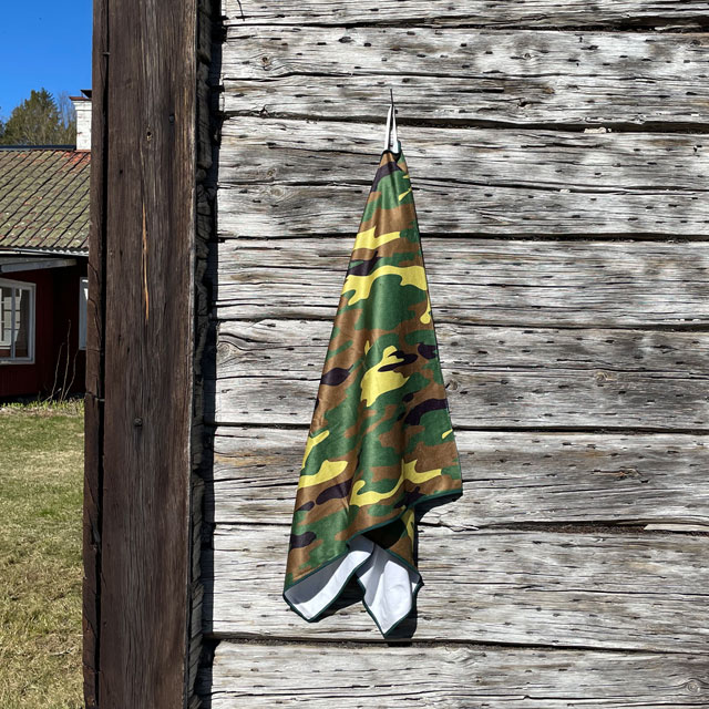 Towel Camouflage from TAC-UP GEAR hanging on a house wall