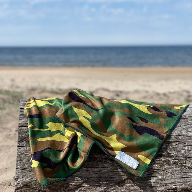 A Towel Camouflage from TAC-UP GEAR on a log at the beach in the sun