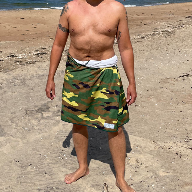 Towel Camouflage from TAC-UP GEAR wrapped around models waist on the beach and seen from the full front