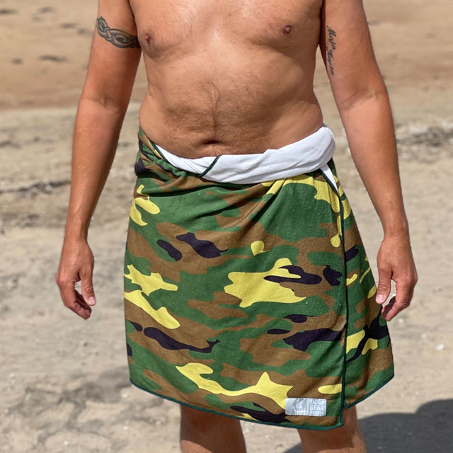 Towel Camouflage from TAC-UP GEAR wrapped around models waist on the beach and seen from the front