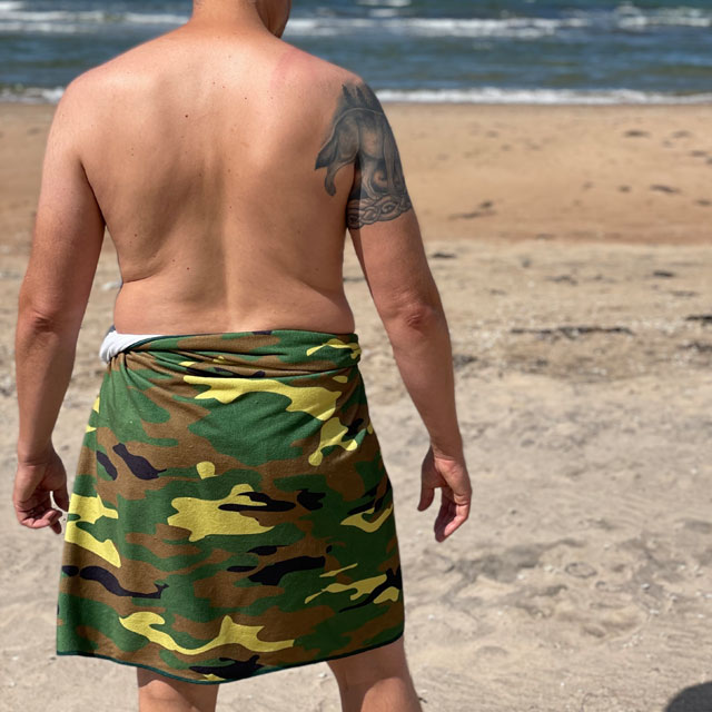 Towel Camouflage from TAC-UP GEAR wrapped around models waist on the beach